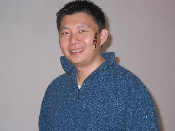 科技时代_图文:脸带彩绘的新浪总裁汪延