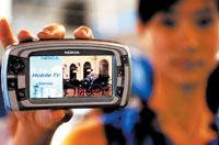 科技时代_今夏手机竞争主打高端市场 3G手机吸引眼球