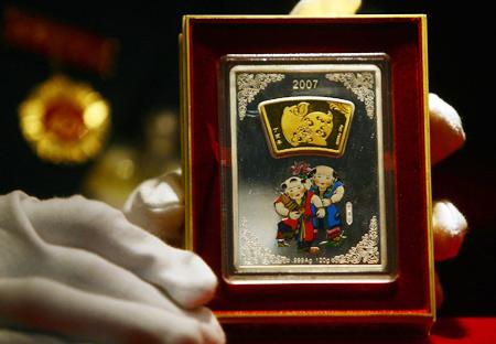 金猪贺禧猪年贺岁金银砖在北京菜百正式首发