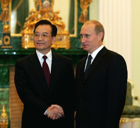 温家宝会见普京中俄相互承认完全市场经济地位
