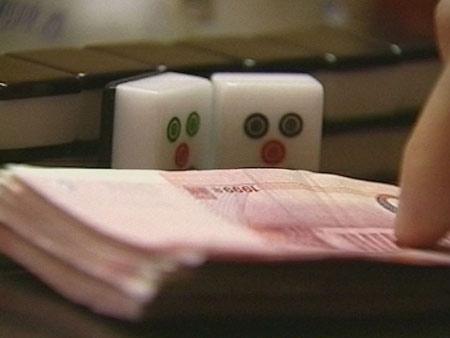 中国地下赌场揭秘:庄家用高科技操纵输赢