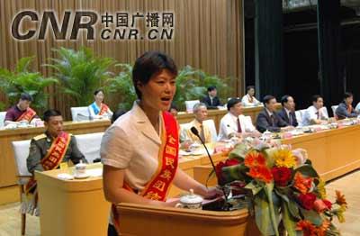 全国民族团结进步模范事迹报告会在南宁举行(组图)