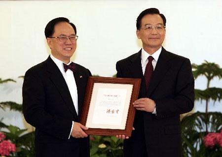 曾荫权宣誓就职仪式9时在京举行温家宝监誓