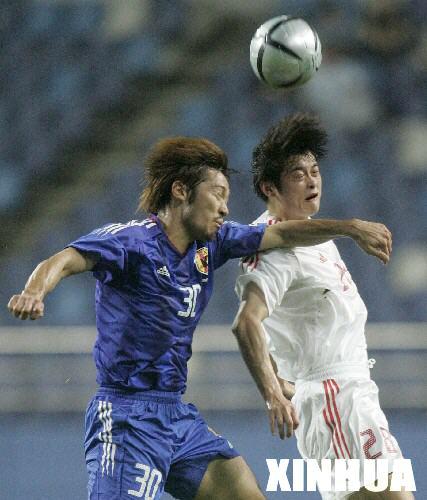 东亚足球锦标赛男足痛失好局2:2战平日本队(组图)