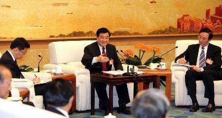 胡锦涛:坚持改革方向毫不动摇并实现新突破