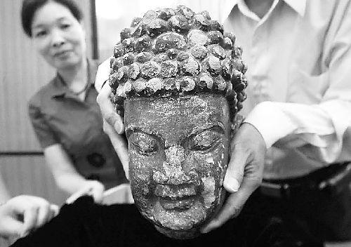 盗割大足石刻释迦牟尼佛头潜逃11年被逮捕(图)