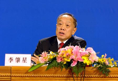图文:外交部长李肇星答俄通社记者问