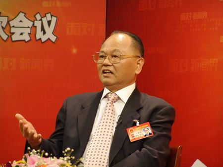 海南省委书记汪啸风谈海南文明生态村(组图)