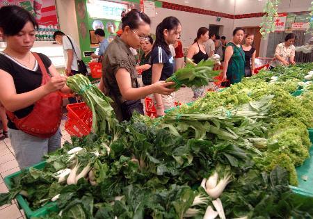"""图文:重庆百余家超市叶类蔬菜""""零点利""""销售"""