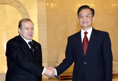 图文:温家宝会见阿尔及利亚总统