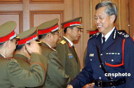 国务院根据香港特首提名任免警务处处长(组图