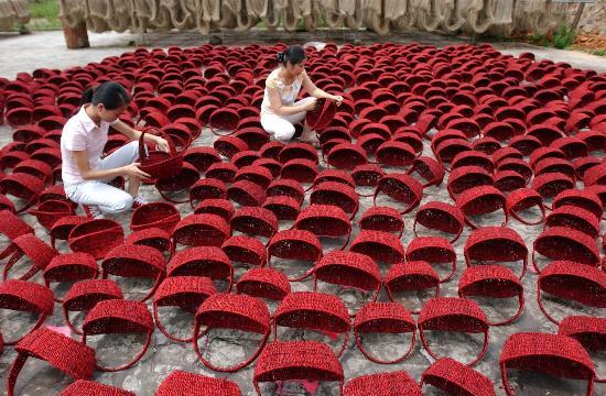 图文:[经济](1)广西博白编织品年销海外10亿元
