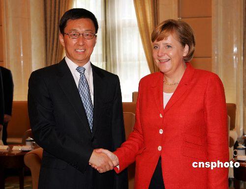 图文:上海市长韩正会见德国总理默克尔