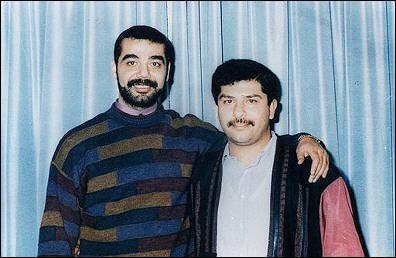 资料照片:萨达姆的两个儿子乌代和库赛