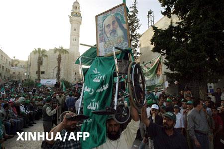 组图:哈马斯支持者游行纪念亚辛遇刺一周年
