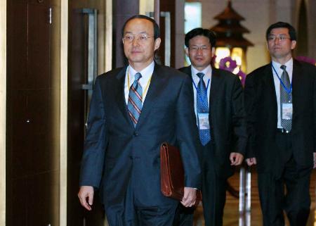 图文:韩国代表团团长离开会场