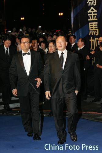 快讯:梁家辉、杜琪峰步上42届金马奖红地毯