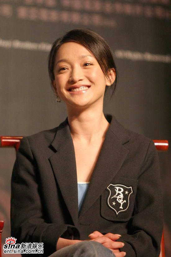 Zhou Xun in a black suit revealing her neck
