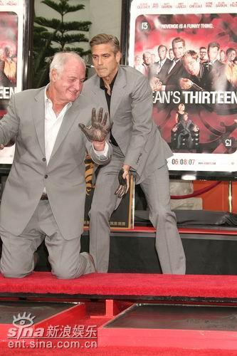 图文:《十三罗汉》洛城首映--克鲁尼和制片人
