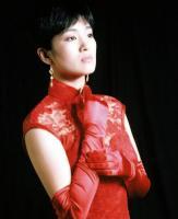 6月27日最美女星:巩俐旗袍写真丰满身材展性感