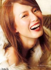 组图:新加坡美女郑秀珍拍艳丽写真集人比花俏