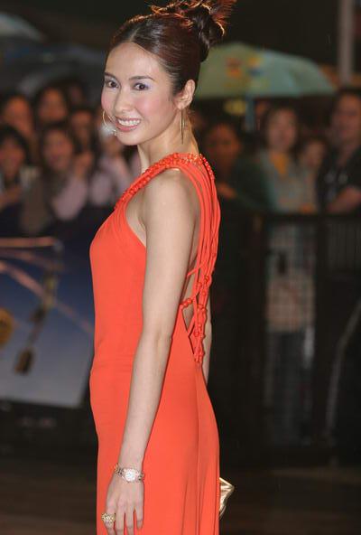 组图:黎姿橙色长袍裹身成熟女人不打性感牌