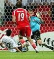 诺伊维尔铲射助德国获胜