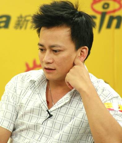 图文-足球报总编刘晓新/记者李承鹏做客沉思网友问题