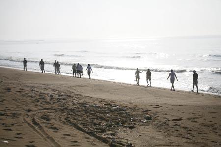 图文-中国高尔夫国家队挥师旭宝队员在海边晨练