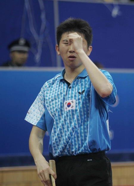 ...男单次轮比赛继续进行,奥运冠军柳承敏不幸出局,图为柳承敏赛