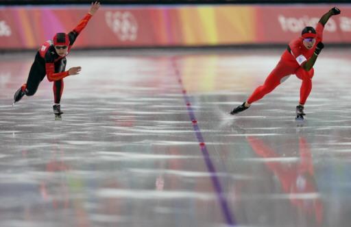 图文-王曼丽500米冲击金牌比对手强壮一圈