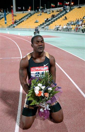 图文-加特林打破百米世界纪录打破纪录跪谢上苍