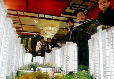 明年的经济适用房由各区政府组织认购