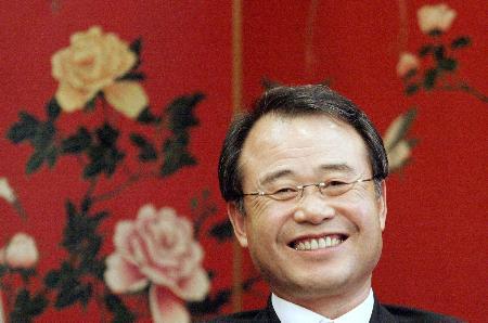 图文-姜荣中当选国际羽联主席姜荣中面带笑容